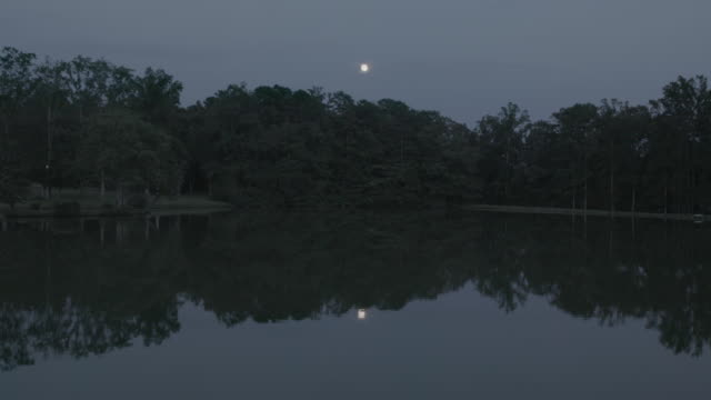 full moon over lake at summer camp, wide shot - summer camp stock videos & royalty-free footage