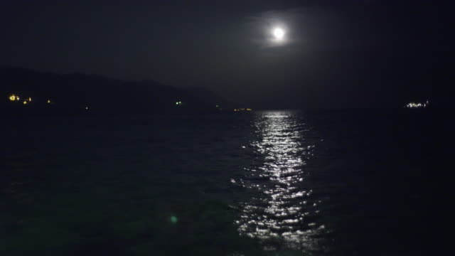 full moon over mediterranen sea - full moon stock videos & royalty-free footage