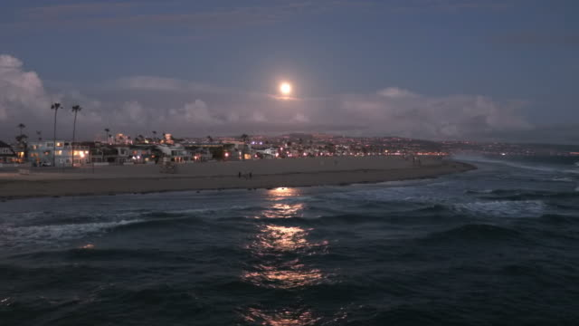 full moon over newport beach, california - full moon stock videos & royalty-free footage