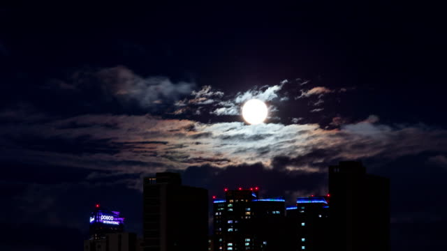 full moon over songdo international business district / incheon, south korea - full moon stock videos & royalty-free footage