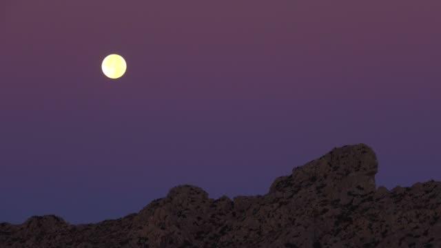 full moon over tramuntana mountains, pollenca, majorca, balearic islands, spain, mediterranean, europe - full moon stock videos & royalty-free footage