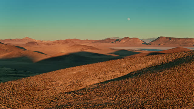 full moon over volcanic landscape - aerial - natural landmark stock videos & royalty-free footage