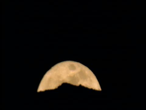 Full moon rises above hills, Ethiopia