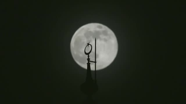 Full moon rises behind the top of a mosque minaret on the night of the ShabeBarat also known as Mid Sha'ban Or Lailatul Barat on May 10 2017 in Van...