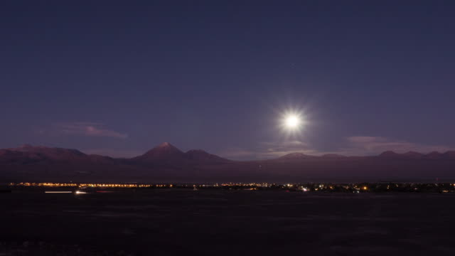 full moon rises over atacama desert at night - full moon stock videos & royalty-free footage