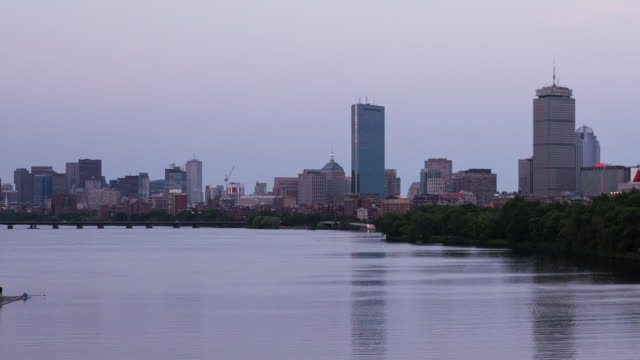 W/S Full Moon rises over Boston Downtown at night. TL day to night