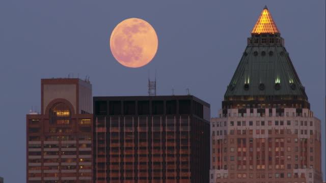 full moon rising above manhattan - supermoon stock videos & royalty-free footage