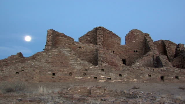 ms, full moon rising above pueblo ruins, chaco culture national historical park, charco canyon,  new mexico, usa - chaco canyon stock videos & royalty-free footage