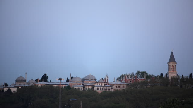 t/l ha ws full moon rising above topkapi palace, day to night, istanbul, turkey - topkapi palace stock videos and b-roll footage