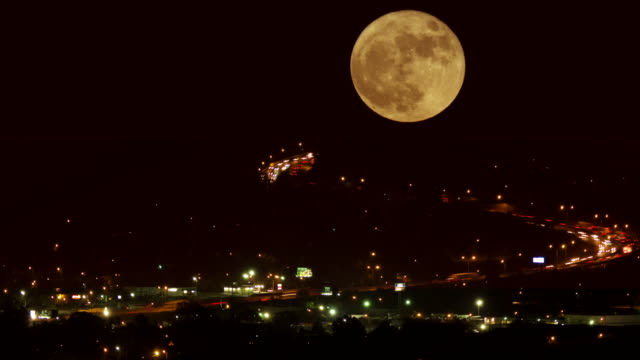 full moon rising and traffic time lapse - supermoon stock videos & royalty-free footage