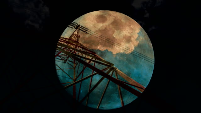 full moon rising behind electricity pylons and lines. - electricity pylon stock videos and b-roll footage