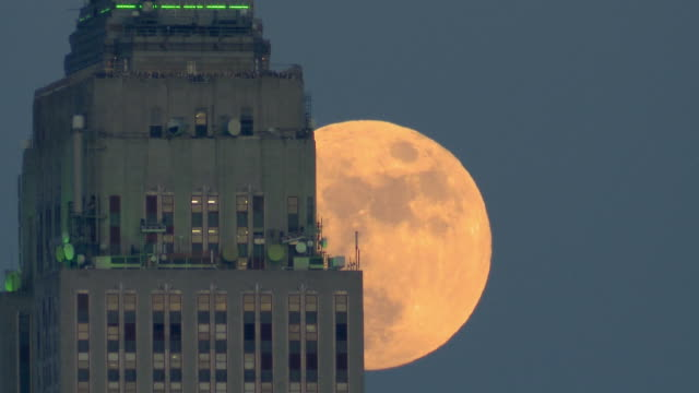 ms t/l full moon rising beside empire state building / new york city, new york, usa - empire state building video stock e b–roll
