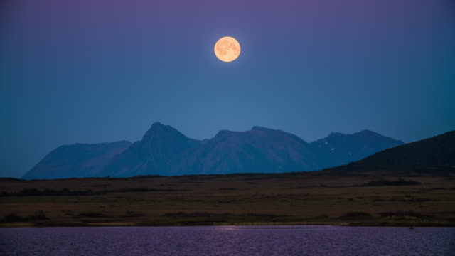 full moon rising over arctic landscape - full moon stock videos & royalty-free footage