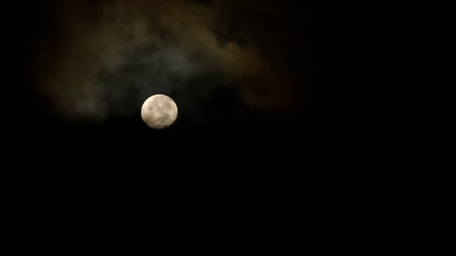 full moon rising over cloud - full moon stock videos & royalty-free footage