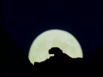 full moon rising over south dakota badlands - badlands stock videos & royalty-free footage