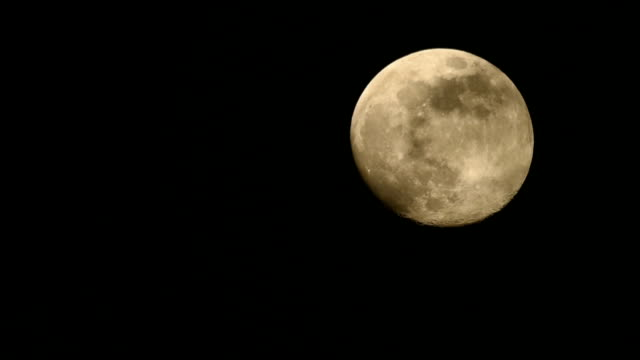 full moon rising up clouds night sky until exit - full hd format stock videos & royalty-free footage
