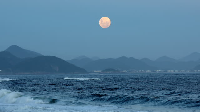 full moon rising - ocean tide stock videos & royalty-free footage