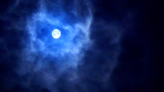 full moon shines on flowing mysterious thin cloud - satellite video stock e b–roll