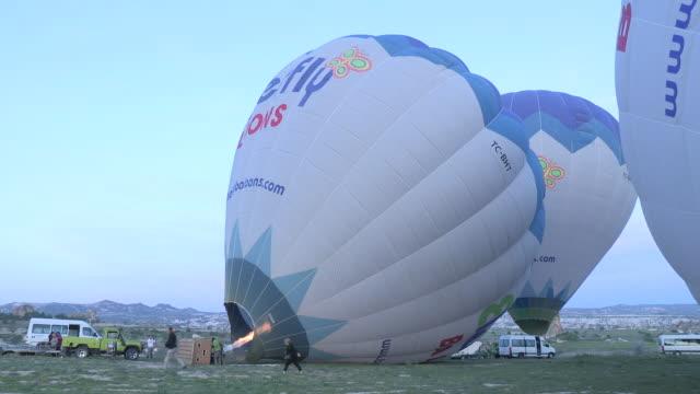 full of hot air, cappadocia, turkey - cappadocia stock videos and b-roll footage