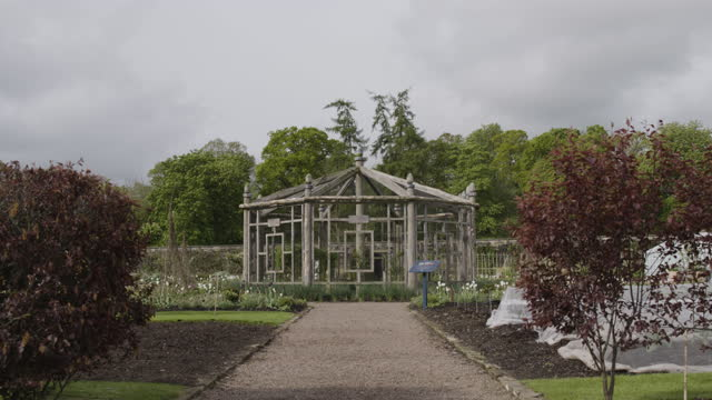 full shot of a fruit cage in the walled garden at floors castle - orchard stock videos & royalty-free footage