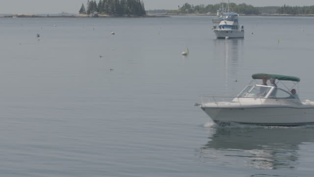 Full shot of a motorboat at Boothbay Harbor