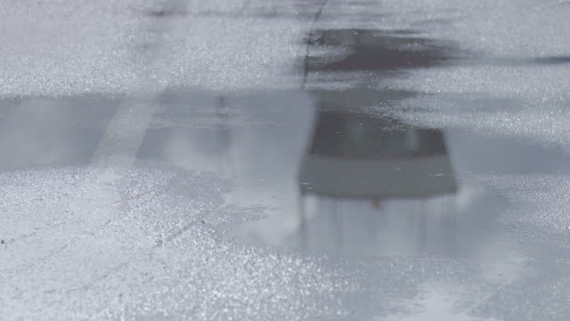 full shot of a puddle with a reflecting control tower at juneau international airport - juneau stock videos and b-roll footage