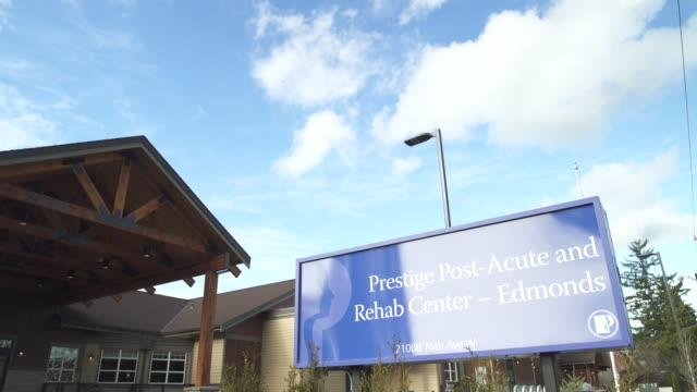 full shot of a rehab center board at daytime - medical building stock videos and b-roll footage