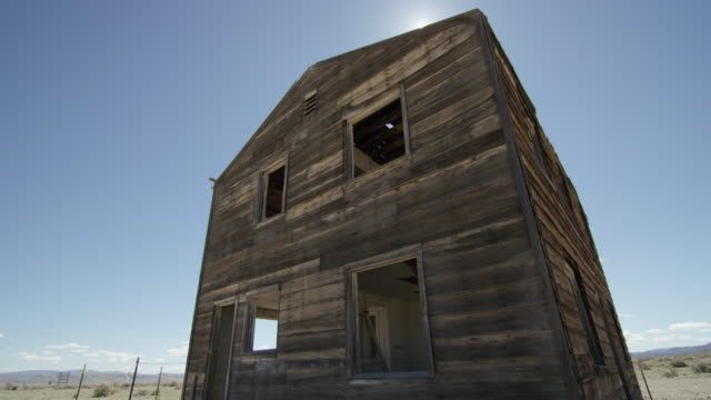 full shot of a ruined house at nevada test site - nevada stock-videos und b-roll-filmmaterial