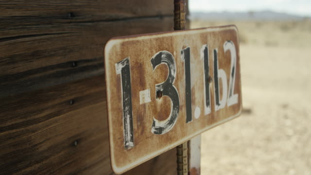 full shot of a rusty sign with numbers at nevada test site - imperfection stock videos & royalty-free footage