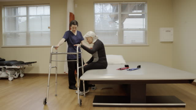 full shot of a senior woman using a walker - walking frame stock videos & royalty-free footage