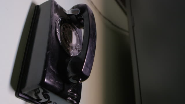 full shot of a vintage rotary telephone at nevada test site - landline phone stock videos & royalty-free footage