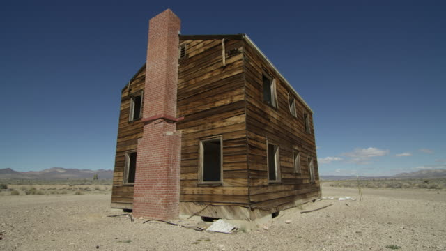 full shot of a wooden test house at nevada test site - nevada stock-videos und b-roll-filmmaterial