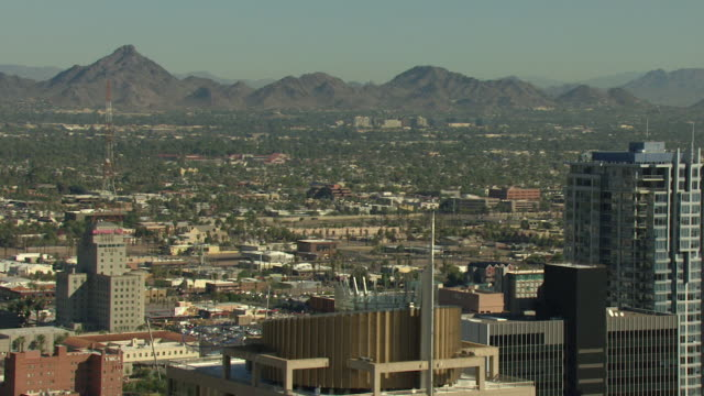 Full shot of buildings in downtown Phoenix with mountains in the background