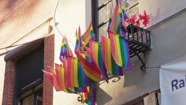 full shot of rainbow flags on the facade of stonewall inn - 1969 stock videos & royalty-free footage