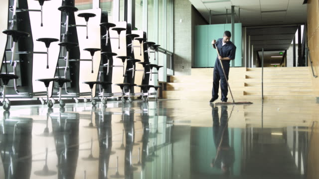 full shot of staff cleaning floor in a high school building - corridor stock videos & royalty-free footage