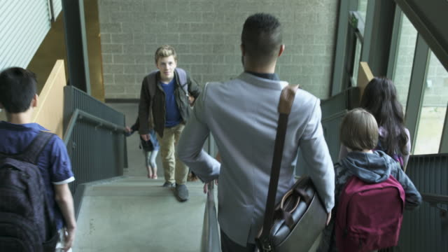 Full shot of students taking the stairs in school