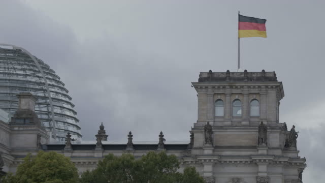 full shot of the german flag on the reichstag building with the cloudy sky in the background - 1933 stock videos & royalty-free footage