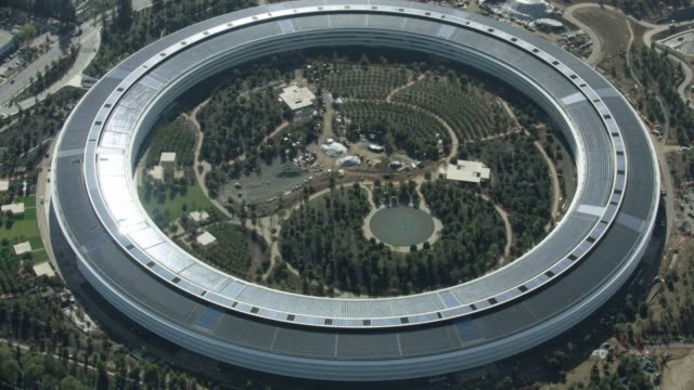 full shot of the giant circular apple park headquarters building - silicon valley stock videos & royalty-free footage