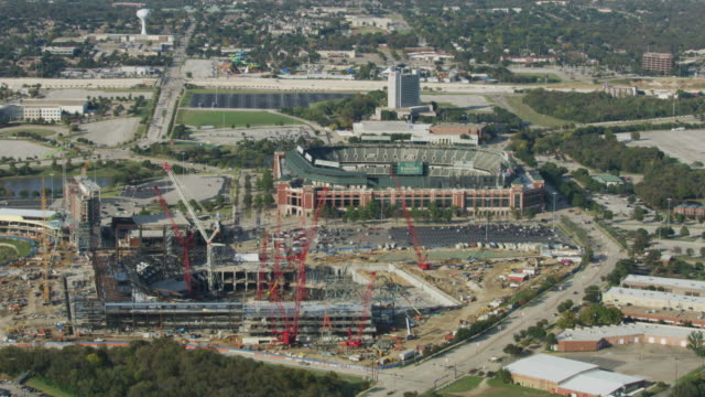 full shot of the globe life field and the globe life park in arlington - アーリントン点の映像素材/bロール