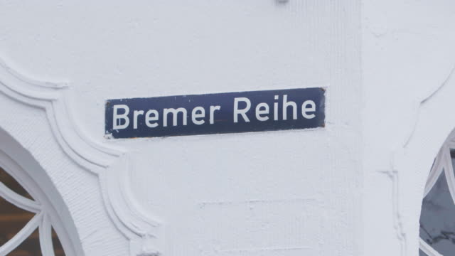 full shot of the name sign of the bremer reihe street in hamburg - street name sign stock videos & royalty-free footage