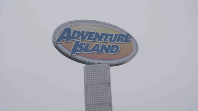 full shot of the sign of the adventure island amusement park in southend-on-sea - logo stock videos & royalty-free footage