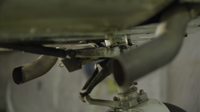 full shot of the tailpipes of a airplane - landefahrwerk stock-videos und b-roll-filmmaterial