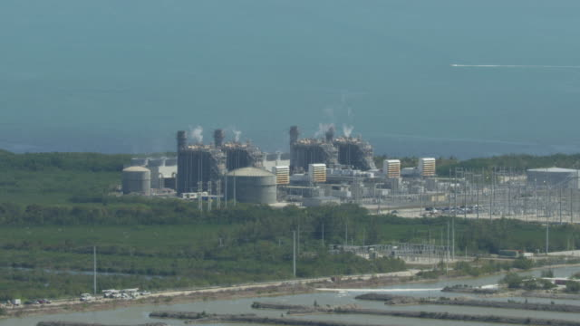 full shot of turkey point nuclear generating station in florida - nuclear power station stock videos & royalty-free footage