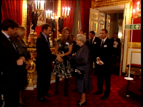 NSPCC 'Full Stop' campaign Reception at St James' Palace ENGLAND London St James Palace EXT Queen Elizabeth II greeting guests including Amir Khan...
