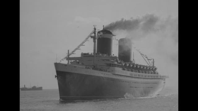 ws full view of ss united states as she sails into harbor / ms smoke billows from smokestacks as ship passes / stern view as ship sails on / flotilla... - normandie stock-videos und b-roll-filmmaterial
