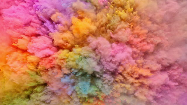 fullframe overhead view of a surface filled with multi pastel colored powder blasting towards camera and bouncing smoky texture in close up and super slow motion - rainbow stock videos & royalty-free footage