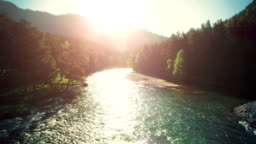 FullHD FHD aerial view. Low flight over fresh cold mountain river at sunny summer morning