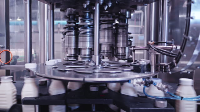 fully automated high speed milk bottling plant - production line stock videos & royalty-free footage