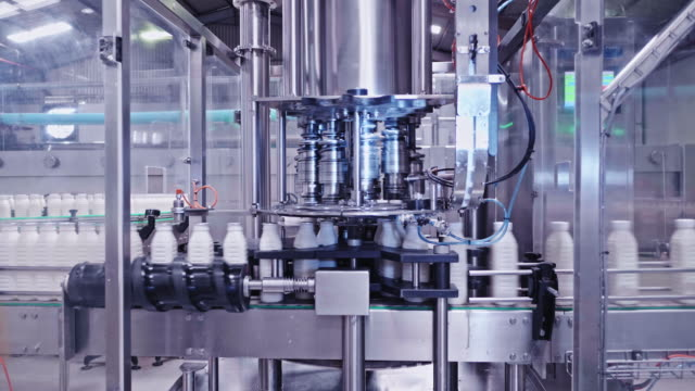 fully automated high speed milk bottling plant - industrial equipment stock videos & royalty-free footage