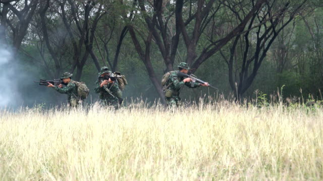 Fully Equipped Soldier group is ready to fight among the conflict